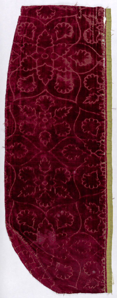 Rosettes enclosing smaller rosettes in red. Fragment formerly part of a chasuble.