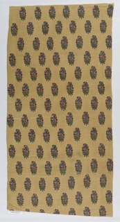 Fragment of block printed cotton in green, red, purple and black on light brown ground. Allover pattern of stylized floral bouquets.