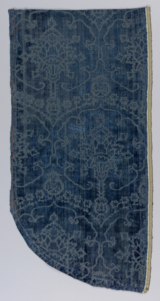 Design based on pomegranite form with rosettes as decoration in blue.