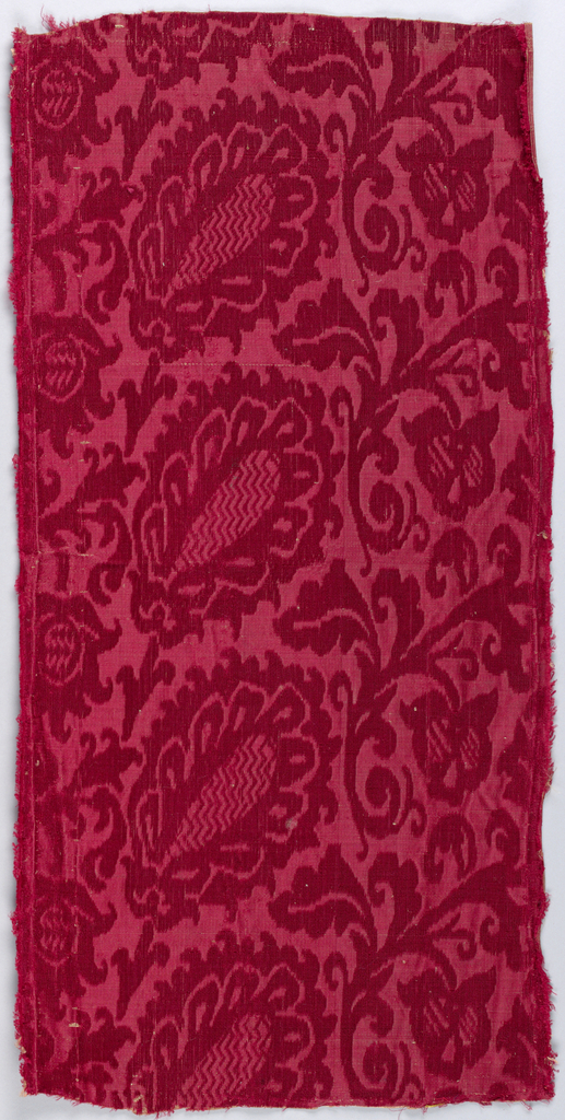 Elongated palmettes and scrolls in red. Floral forms have zigzag motifs.