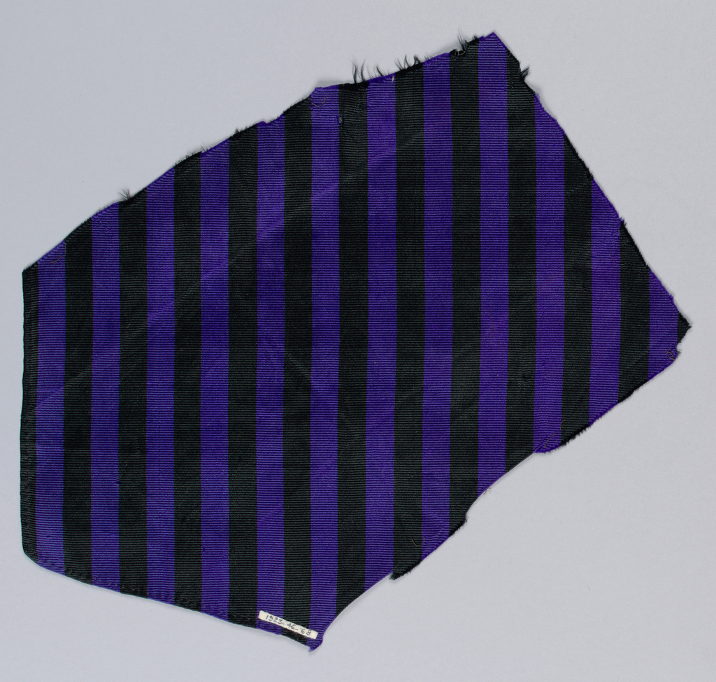 Striped black and purple ribbed silk fragment.