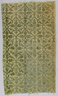 Two small fragments of green velvet with cut and uncut pile on a cream-colored ground. Pattern is an intertwined lattice enclosing small-scale stylized plant design.
