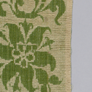 Border strip with pattern of flowers showing the linen face of the satin and background of green silk.