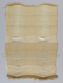 Novelty weave with broad chevron stripes alternating with plain twill stripes. Increasing number of grouped warps toward the center causes a change in tension. In white, gray and tan.