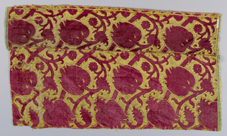 Swinging branches with pomegranates and tulips in red on yellow. Red cut and uncut velvet design of swinging branches with tulips and foliage, on yellow satin ground. Ciselè voided satin velvet.