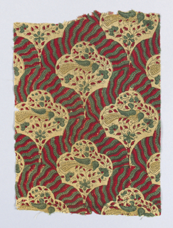 Red and green stripes offset tan medallions which enclose a bird and flowering branches.
