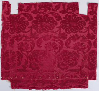 Elongated peony and palm motifs in red.