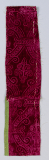 Pieced fragment with embossed (stamped) pattern of strapwork forming cartouches containing elaborate fleur de lys on plain red velvet.