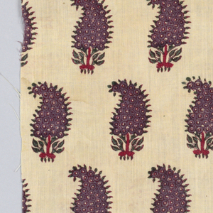 Fragment of cotton block-printed in purple, brown, red, and green on cream-colored ground.  All-over stylized floral patter resembling pansies.