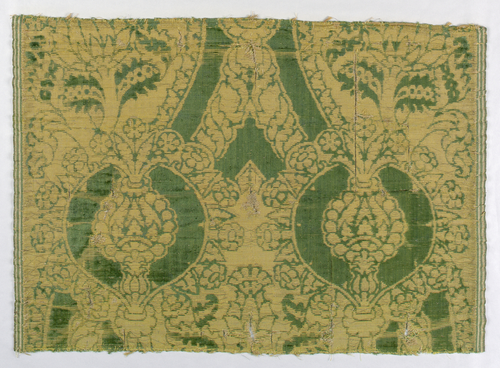 Two fragments, each with both selvages present. Large scale pomegranate design in green and gold.