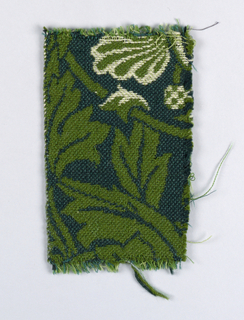 Large-scale allover design of curving leaves and stems and small flowers in dark yellow-green, pale grey-blue, and white on dark blue ground. One plain selvage.
