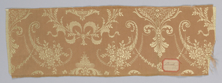 "a. pink/tan ground with gold color arabesque motif with flowers and ribbons b. the same as ""a"""