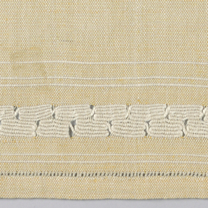 """Fine natural linen warp and fine pale orange weft. Loosely woven with heavy off-white weft forming inlay in """"Spanish lace"""" effect."""