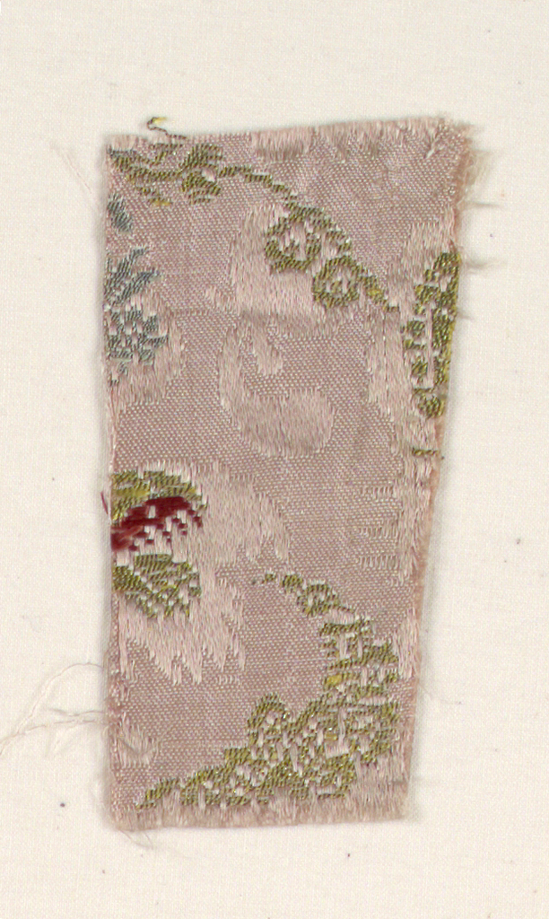 Pink ground with satin weave outlining the brocaded design. Very incomplete design of horizontal rows of floral motifs and small birds in red silk and silver and gold thread.