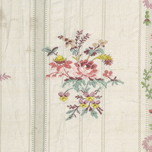 Striped white taffeta with small-scale floral sprays brocaded in polychrome silks.