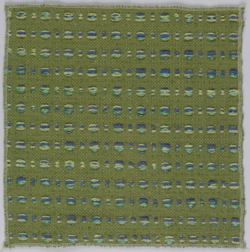 Olive green ground with regularly spaced small squares formed by warp floats in a combination of deep blue, yellow-green, and olive green.