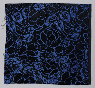 Panel of jacquard, hand-cut satin, showing life-size floral pattern in blue; reversible, with velvet-filled areas.