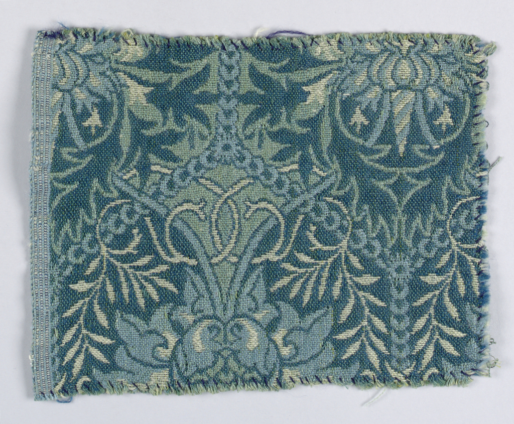 Design with a symmetrical allover pattern of confronted birds among leaves and flowers. In shades of green and pink, with off-white and pale blue on dark blue-green ground.