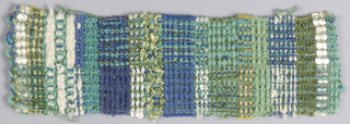 Plaid in green, blue and white with gold metallic.