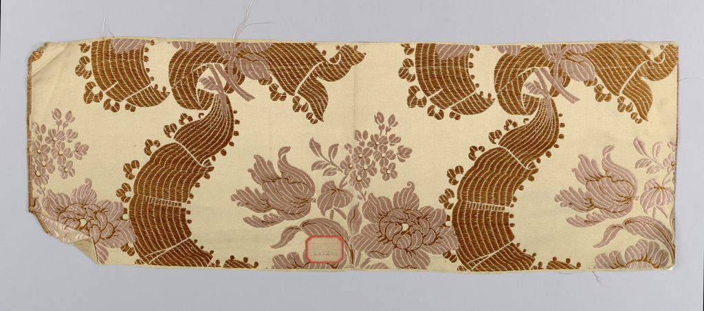 tan warp and pink and brown/red wefts making floral with ribbon pattern