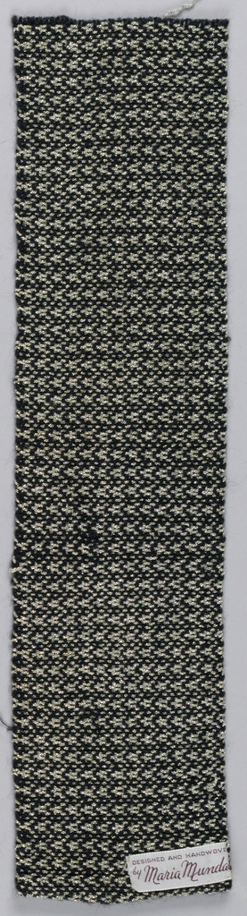 Small allover pattern of squares outlilned in black on silver ground. Selvages continuous with field on both long sides.