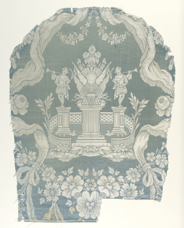 Incomplete repeat showing symmetrical design of swags of fringed ribbon with floral festoon at bottom, enclosing array of trophies on column with trumpeter on either side in small fenced enclosure. In white twill and cloth tie on sky blue strie satin ground.