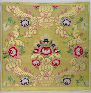 Sample of material woven for the Russian church. Gold ground with symmetrical design of central group of roses surrounded by serpentines of horns of plenty, wheat, roses and other flowers. Design brocaded in rose, green, and purple silk; purple and rose chenille; gold and silver.