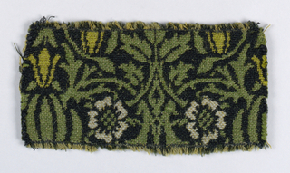 All over medium-scale symmetrical floral and leaf design in pale grey, dark green, and yellow-green on a black ground.