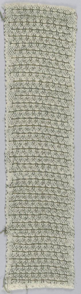 White warp with olive green and copper yarn weft form narrow horiozontal rows. Olive green and copper thread in same shed. Two cloth selvages continuous with field.
