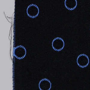 Fragment of jacquard, hand-cut satin, showing pattern of all-over circles in blue. Areas filled with velvet. Pattern reversible.