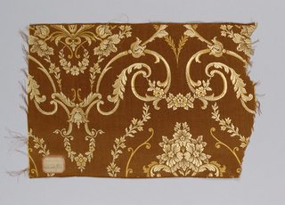 red/brown warp and two shades of gold color weft making  a floral arabesque pattern