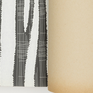 A selection of designs, each shown in multiple colorways. A black and white photo shows the design in repeat with a coordinating fabric. Also, wallpapers are shown with a coordinating paper.