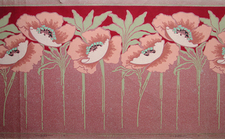 Large-scale poppies on stem with flowers running along top edge and stems at bottom. The space between the band of poppy flowers and the top edge is printed deep red. Printed on pink oatmeal paper.