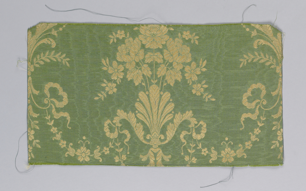 Green morie effect ground with gold color floral pattern.