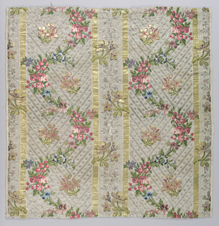 Floral serpentines brocaded in colored silks on background of gold and silver arranged in vertical stripes.