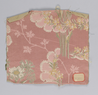 pink warp with yellow, white and grey weft making floral pattern