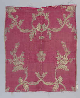 Red ground with horizontal ribs produced by floats of secondary warps. Pattern of broadly undulating floral forms brocaded in gold thread.
