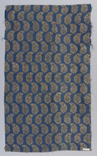 Pattern of horizontal rows of floral botehs in pink and gold on a blue ground. Textile is composed of several fragments pieced together.