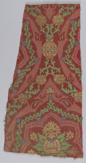 Incomplete design of large scale pomegranates and interlaced strapwork.