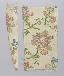 White grosgrain with ground figure of lace-like serpentine. Large-scale sprays of roses and other flowers brocaded in polychrome silks, gold metal thread and flat silver.