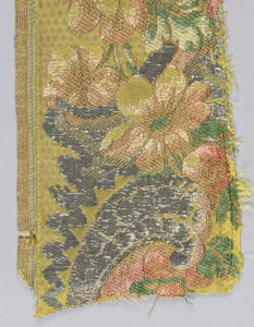 "Woven silk  with a design of a garden pedestal with large shell and florals, framing a landscape. With some elements of the ""bizarre"" style. Supplementary wefts of cream, green, beige and metallic yarns on a pale green ground."