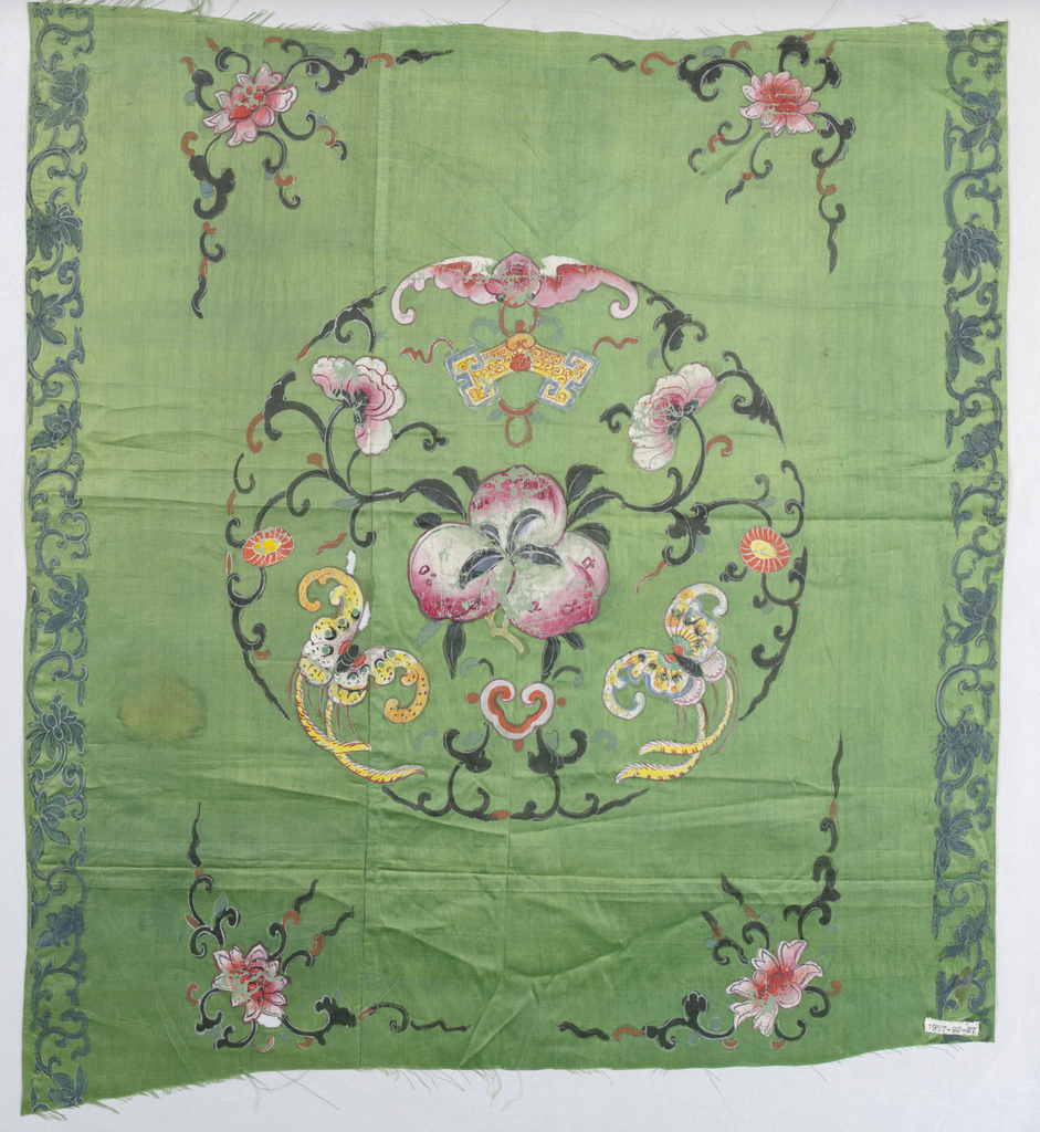 Bright grass-green satin with large central medallion with flowers, peaches, lucky emblems, lotus arabesque in each corner, narrow floral border with two sides. In dark gray and brilliant colors of ink and thick goauche paint, which is worn and cracked in places. Narrow twilled selvage.