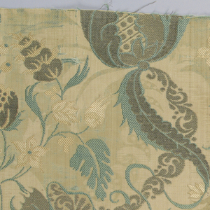 Ivory white silk brocaded with rose silk, now faded, green silk, and silver. Satin weave ground with complete background pattern of foliage and scrolls in transverse rib, supporting the main design of a symmetrical scrolling vine in silver and green. A large fruit form and horn-shaped element  with diagonal repeat in the 'bizarre' style. Small flower clusters fill interstices. Both selvages present.