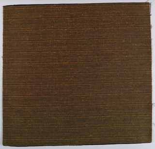 Square of upholstery fabric in black, brown and irregularly-placed orange stripes.