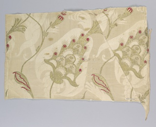 Length of woven silk in the so-called bizarre style, with fantastic vegetal forms on sinuous branches in gold brocade with touches of red, on a cream-colored satin damask ground.