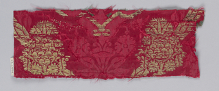 Red damask weave with gold. Ogival pattern.