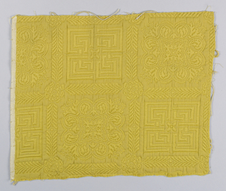 Upholstery fabric sample with mock Chinese motifs in yellow. Weave has matelassé effect.