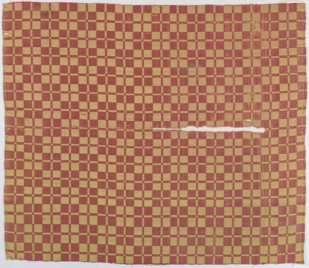 Checkerboard pattern in dark pink and yellow.