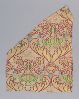 White silk warp. Wefts used together, of white, red, yellow, blue, green and pink silks and flat strips of silver. Background white with incomplete design of ogives formed by a large leaves with crowns at intersections, each ogive enclosing an urn with flowers. Clear colors appear only in narrow outlines of design where extra wefts are floated out. In rest of fabric white warps appear over mixed wefts thus dulling colors.