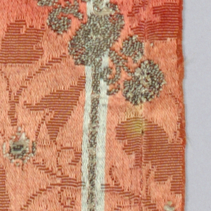 Orange/red ground with verical stripes of blue silk and silver metallic in a floral pattern.